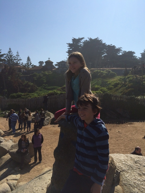 Kids on rocks at Isla Negra